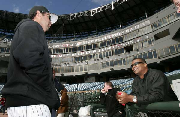 Chicago White Sox manager Ozzie Guillen, left, talks with White Sox general manager Ken Williams, right, during practice Sunday, Oct. 9, 2005 in Chicago. The White Sox took three straight games from the Boston Red Sox to win the American League Division Series and are waiting to find out if they will play the New York Yankees or the Los Angeles Angels in the American League Championship Series.  <span class=meta>(AP Photo&#47;Jeff Roberson)</span>